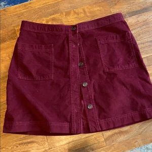 Cute Maroon corduroy skirt with  front pockets.